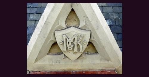 The McKennas' 'McK' monogram above the oriel window on The Picturehouse building, part of Band on the Wall since 2009