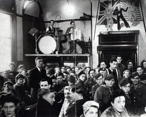 Figure 7 – Musicians on stage at Band on the Wall during World War II, probably Rudi Mancini, accordion, and Jim Hart, drums, c1943